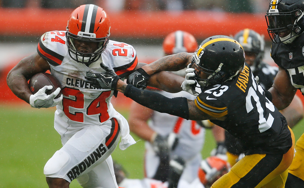 . Cleveland Browns running back Nick Chubb (24) rushes against Pittsburgh Steelers defensive back Joe Haden (23) during the second half of an NFL football game, Sunday, Sept. 9, 2018, in Cleveland. (AP Photo/Ron Schwane)