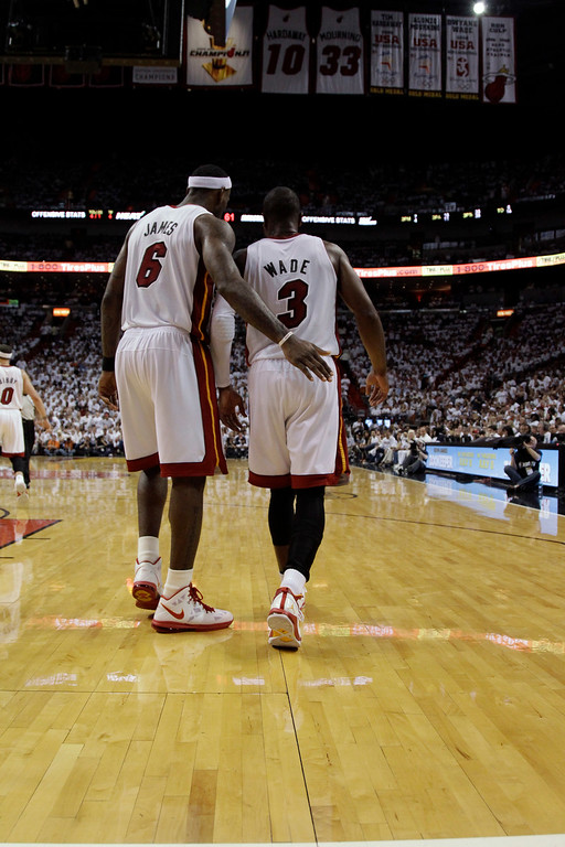 . Miami Heat\'s LeBron James, left, and Dwyane Wade talk as they walk down the floor against the Dallas Mavericks during the second half of Game 2 of the NBA Finals basketball game Thursday, June 2, 2011, in Miami. (AP Photo/David J. Phillip)