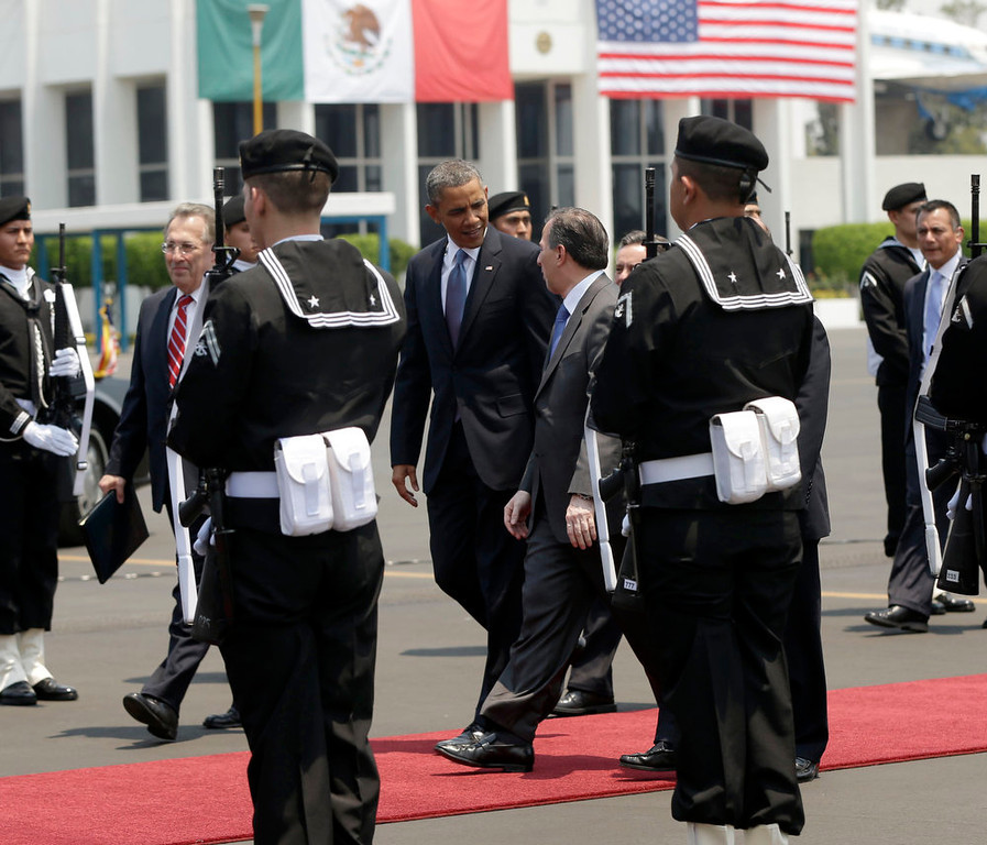 . President Barack Obama, center, walks on the tarmac to his vehicle upon his arrival at Benito Juarez International Airport in Mexico City, Thursday, May 2, 2013. Obama is traveling on a three-day trip to Mexico an Costa Rica. (AP Photo/Pablo Martinez Monsivais)