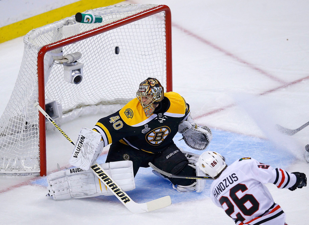 . Chicago Blackhawks\' Michal Handzus (26) scores on Boston Bruins goalie Tuukka Rask during the first period in Game 4 of their NHL Stanley Cup Finals hockey series in Boston, Massachusetts, June 19, 2013. REUTERS/Brian Snyder
