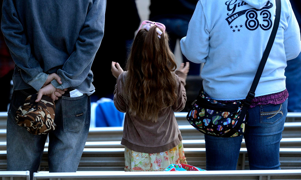 . A little girl raises her hands in worship during Easter Sunrise services at the Roosevelt Bowl in San Bernardino March 31, 2013.  GABRIEL LUIS ACOSTA/STAFF PHOTOGRAPHER.