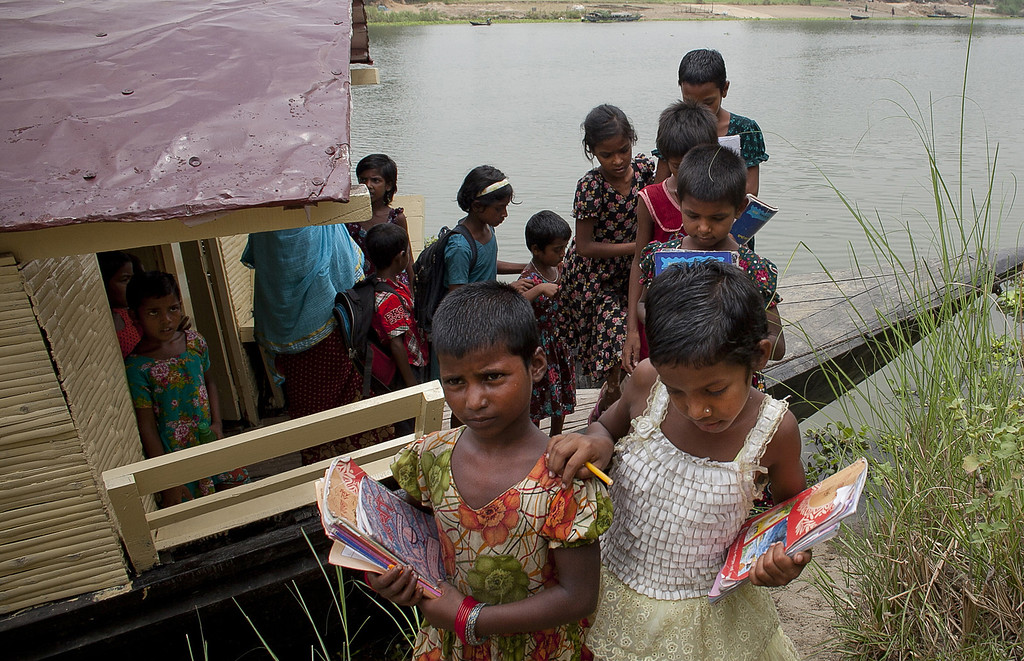 """. Children are let out from class for the day from a solar powered \""""floating school\"""" operated by Shidhulai Swanirvar Sangstha May 20, 2014 in Pabna district, Bangladesh.  (Photo by Allison Joyce/Getty Images)"""