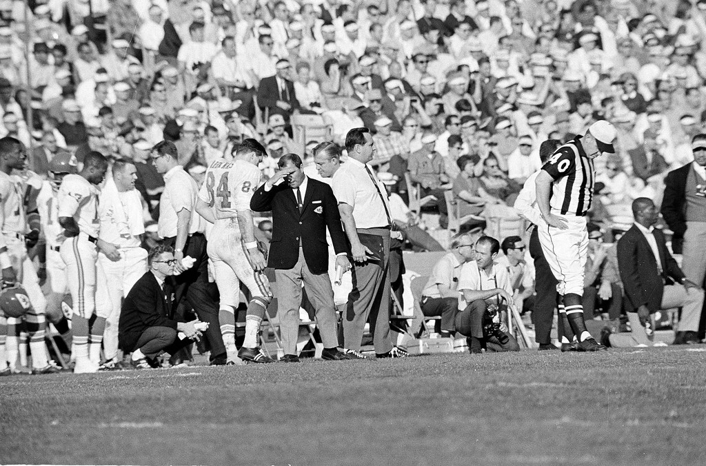 . Coach Hank Stram, dark jacket, of the Kansas City Chiefs suffers through his team\'s 35-10 loss to the Green Bay Packers during Super Bowl I at the Los Angeles Memorial Coliseum in Los Angeles, Calif., Jan. 15, 1967. (AP Photo)