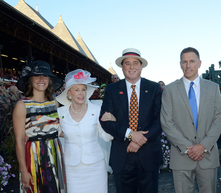 . Marylou Whitney and John Hendrickson stand with Aaron Ditch and wife Amy Domurad-Ditch of Saratoga Springs before Aaron placed his $15,000 bet on Verrazano who place out of the money. Photo Ed Burke/SARATOGIAN 8/24/13