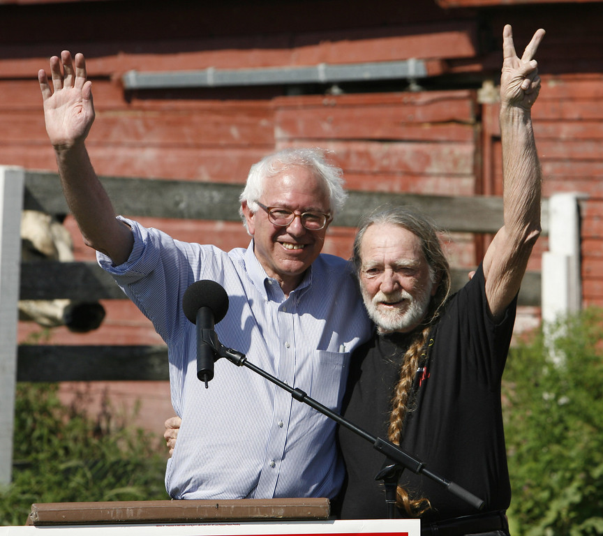 . Entertainer Willie Nelson, right, appears at a rally in support of Rep. Bernie Sanders, I-Vt., left, at a farm in Charlotte, Vt., Tuesday, Aug. 8, 2006. (AP Photo/Toby Talbot)