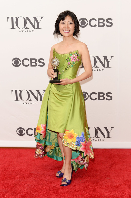 """. Costume designer Linda Cho, winner of the award for Best Costume Design of a Musical for \""""?A Gentleman\'s Guide to Love and Murder\""""? poses in the press room during the 68th Annual Tony Awards on June 8, 2014 in New York City.  (Photo by Andrew H. Walker/Getty Images for Tony Awards Productions)"""