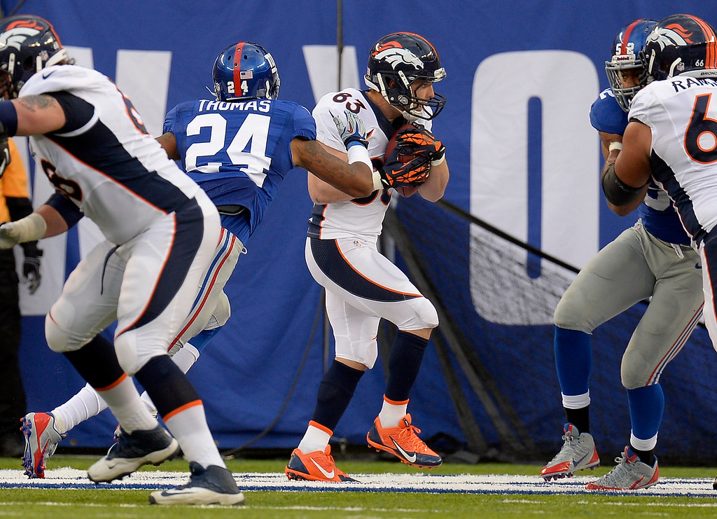 . Denver Broncos wide receiver Wes Welker (83) catches a pass for a touchdown on New York Giants defensive back Terrell Thomas (24) during the third quarter September 15, 2013 MetLife Stadium. (Photo by John Leyba/The Denver Post)