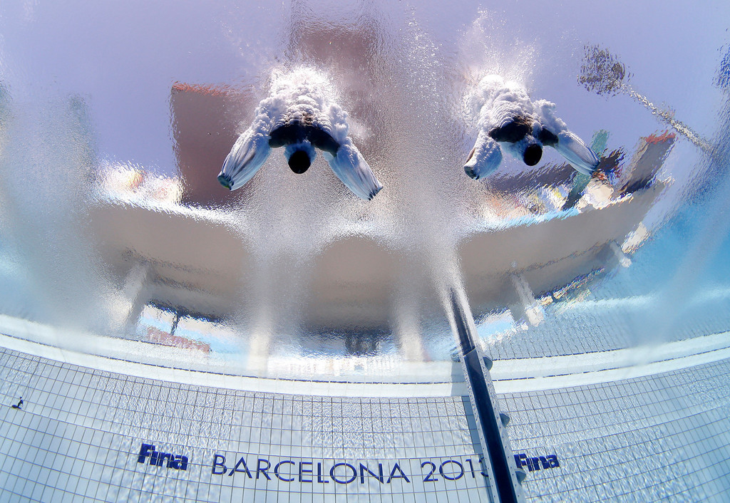 . Sascha Klein and Patrick Hausding of Germany compete in the men\'s 10-meter synchro platfrom preliminary competition at the FINA Swimming World Championships in Barcelona, Spain, Sunday, July 21, 2013. (AP Photo/David J. Phillip, File)