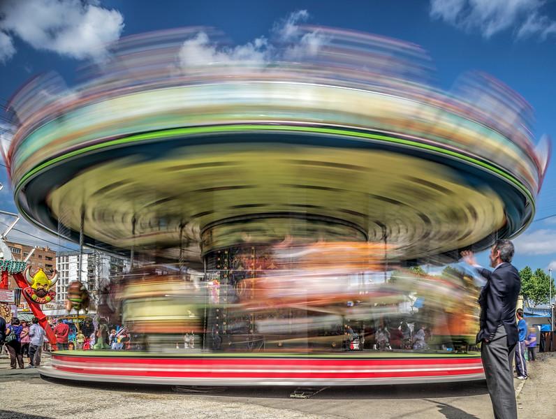 Carousel in a funfair, Feria de Abril, Seville, Spain. Long exposure shot.