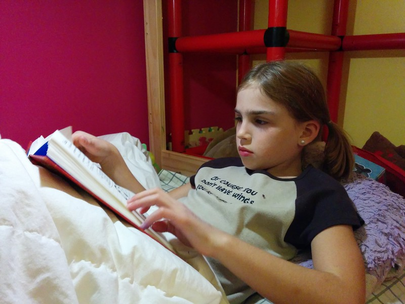 Reading in bed.