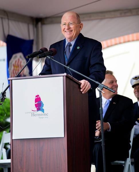 Chairman Shepard at podium smiling.jpg