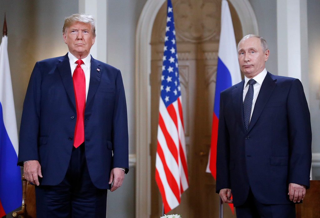 . U.S. President Donald Trump, left, and Russian President Vladimir Putin pose for a photograph at the beginning of a one-on-one meeting at the Presidential Palace in Helsinki, Finland, Monday, July 16, 2018. (AP Photo/Pablo Martinez Monsivais)