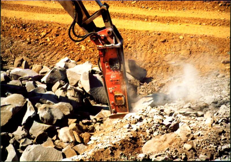 NPK E220 hydraulic hammer on Cat excavator-secondary breaking (1).JPG