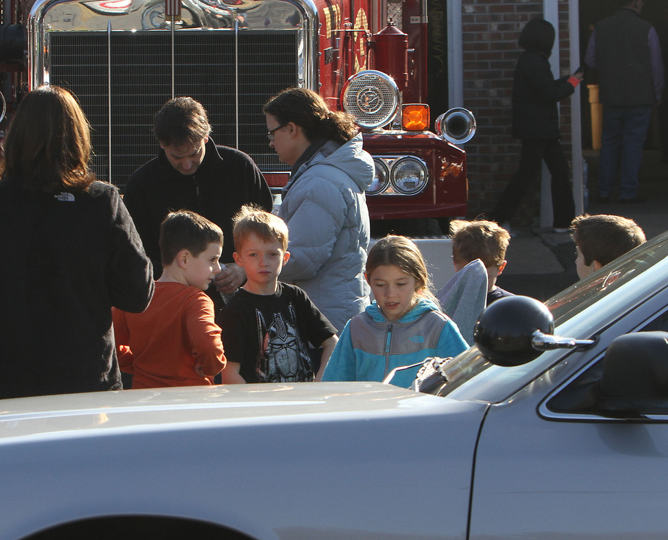 . School children wait for their parents at the Sandy Hook firehouse following a mass shooting at the Sandy Hook Elementary School in Newtown, Conn. where authorities say a gunman opened fire, leaving 27 people dead, including 20 children, Friday, Dec. 14, 2012. (AP Photo/The Journal News, Frank Becerra Jr.)