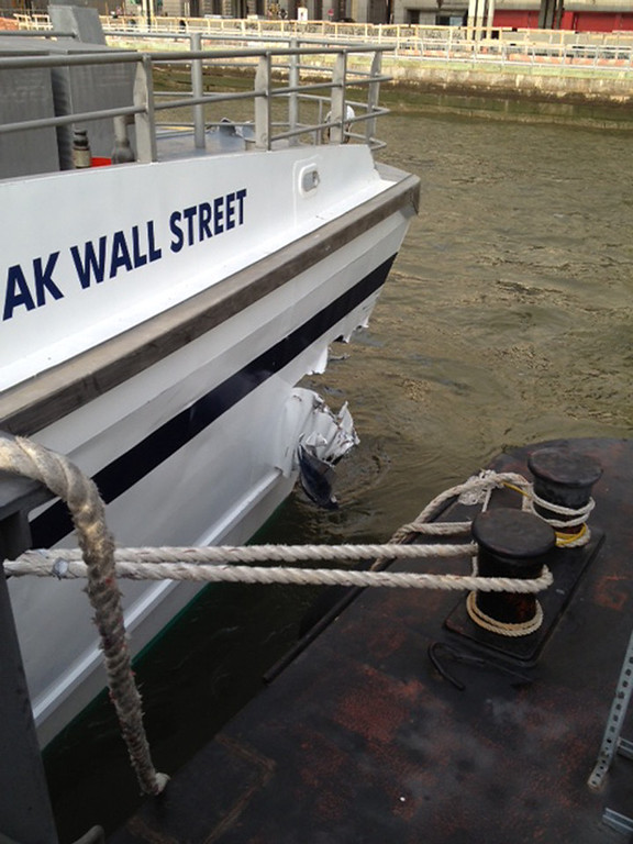. A hole is torn near the bow of the Seastreak Wall Street ferry after it banged into the mooring as it arrived at a pier in New York\'s financial district Wednesday, Jan. 9, 2013. Police and fire officials say 30 to 50 people were injured when the ferry struck a dock during the morning rush hour. (AP Photo/Frank McLaughlin)