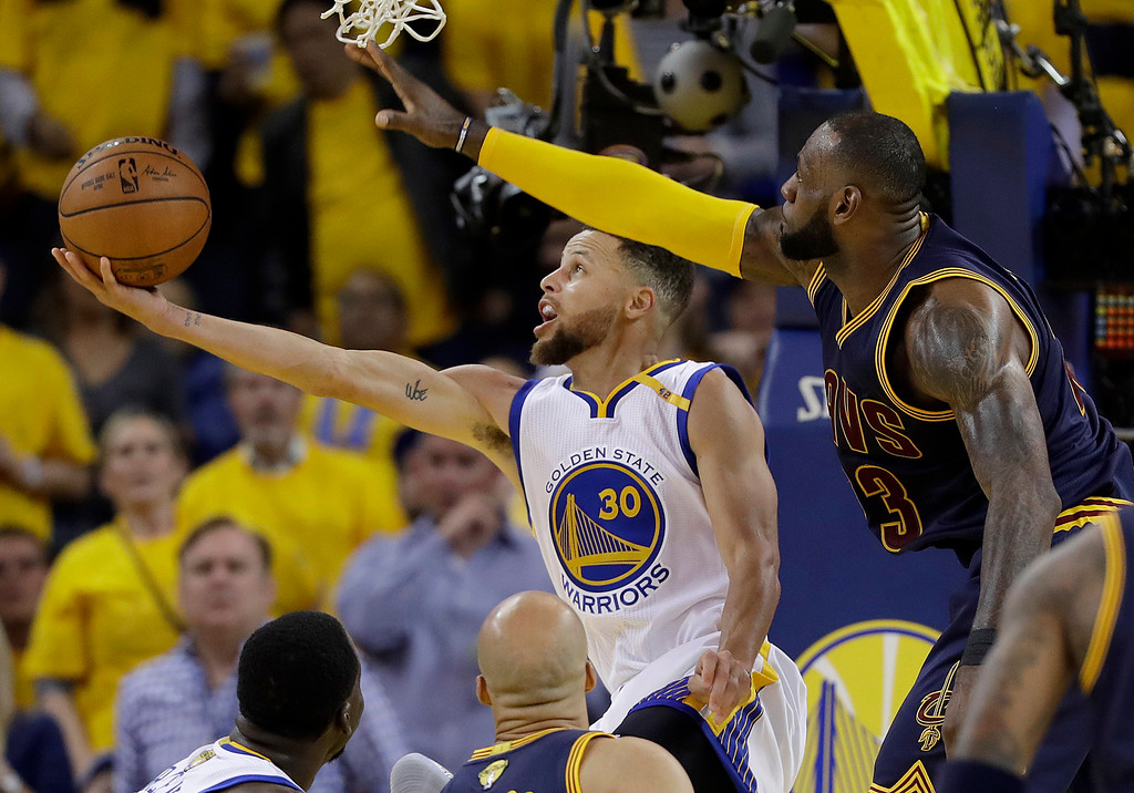 . Golden State Warriors guard Stephen Curry (30) shoots against Cleveland Cavaliers forward LeBron James during the second half of Game 1 of basketball\'s NBA Finals in Oakland, Calif., Thursday, June 1, 2017. (AP Photo/Marcio Jose Sanchez)
