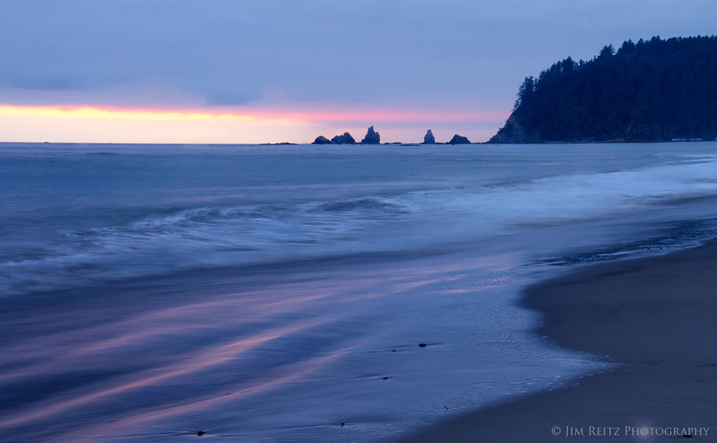 A thin line of light is all that's visible at sunset, Rialto Beach, La Push, WA
