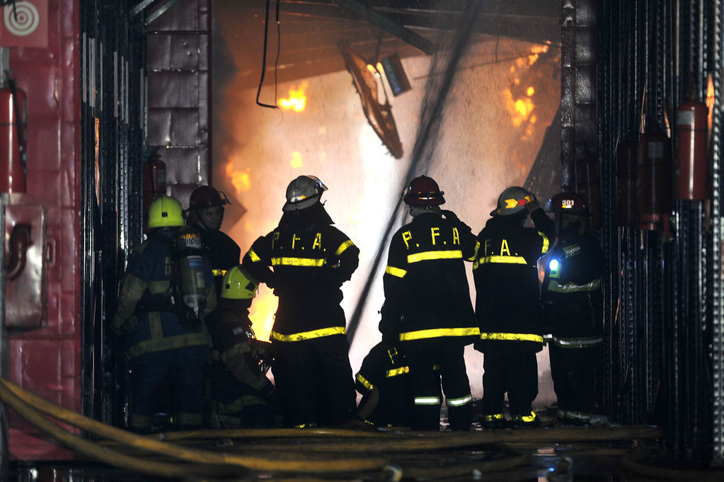. Firefighters work to extinguish a fire at the Iron Mountain warehouse in Buenos Aires, Argentina, Wednesday, Feb. 5, 2014. (AP Photo/Telam, Daniel Dabove)