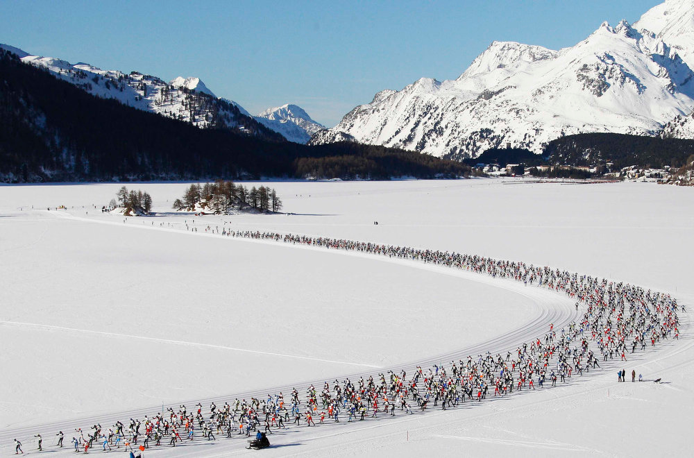 . An aerial view shows cross country skiers racing over the frozen Lake Sils during the Engadin Ski Marathon near the village of Maloja March 10, 2013. More than 12,000 skiers participated in the 26.2 miles race between Maloja and S-chanf near the Swiss mountain resort of St. Moritz. REUTERS/Michael Buholzer