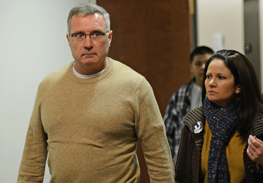 . Thomas Teves, left, and his wife Caren Teves, head back into the court room after a break, Monday, January 7, 2013, in Centennial. RJ Sangosti, The Denver Post