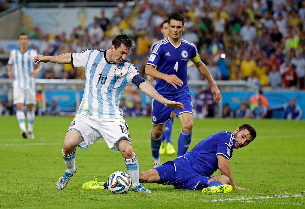 . Argentina\'s Lionel Messi, left, in action during the group F World Cup soccer match between Argentina and Bosnia at the Maracana Stadium in Rio de Janeiro, Brazil, Sunday, June 15, 2014.  (AP Photo/Felipe Dana)