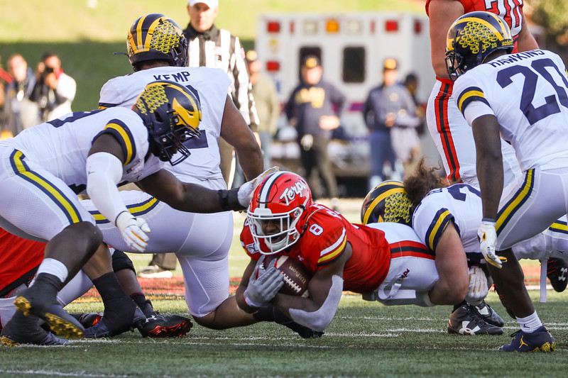 Terps RB Tayon Fleet-Davis dives for the Maryland first down.