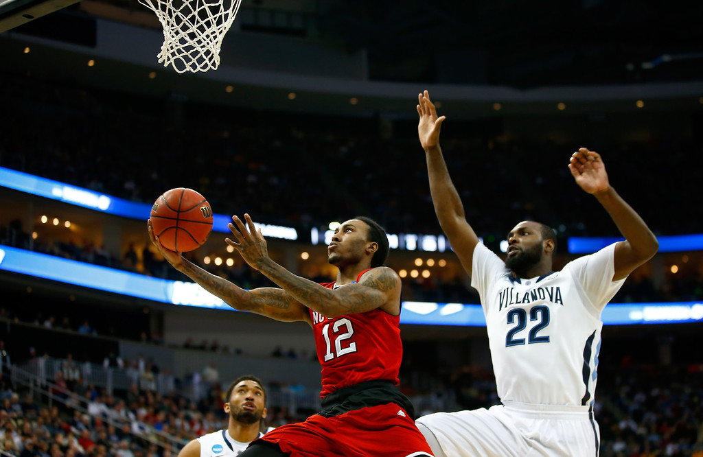. Anthony Barber #12 of the North Carolina State Wolfpack puts up a shot in front of JayVaughn Pinkston #22 of the Villanova Wildcats in the second half during the third round of the 2015 NCAA Men\'s Basketball Tournament at Consol Energy Center on March 21, 2015 in Pittsburgh, Pennsylvania.  (Photo by Jared Wickerham/Getty Images)