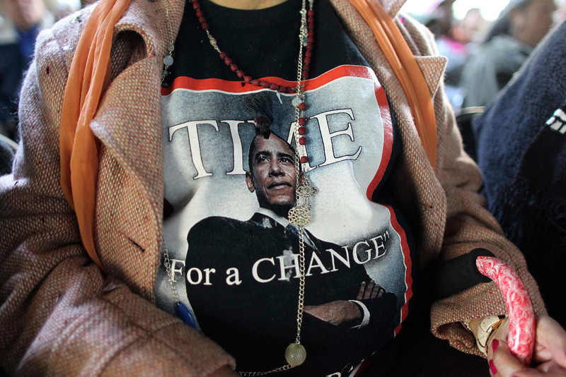 ". Vilma Mendez wears a t-shirt in support of the president as black and Latino activists gather to watch President Barack Obama take the oath of office, in Gardena, California, January 21, 2013. Obama urged Americans on Monday to reject political ""absolutism\"" and partisan rancor as he kicked off his second term with a call for national unity, setting a pragmatic tone for the daunting challenges he faces over the next four years.  REUTERS/David McNew"