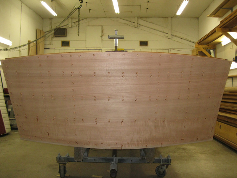 Transom planks sanded for the first time and plugged.