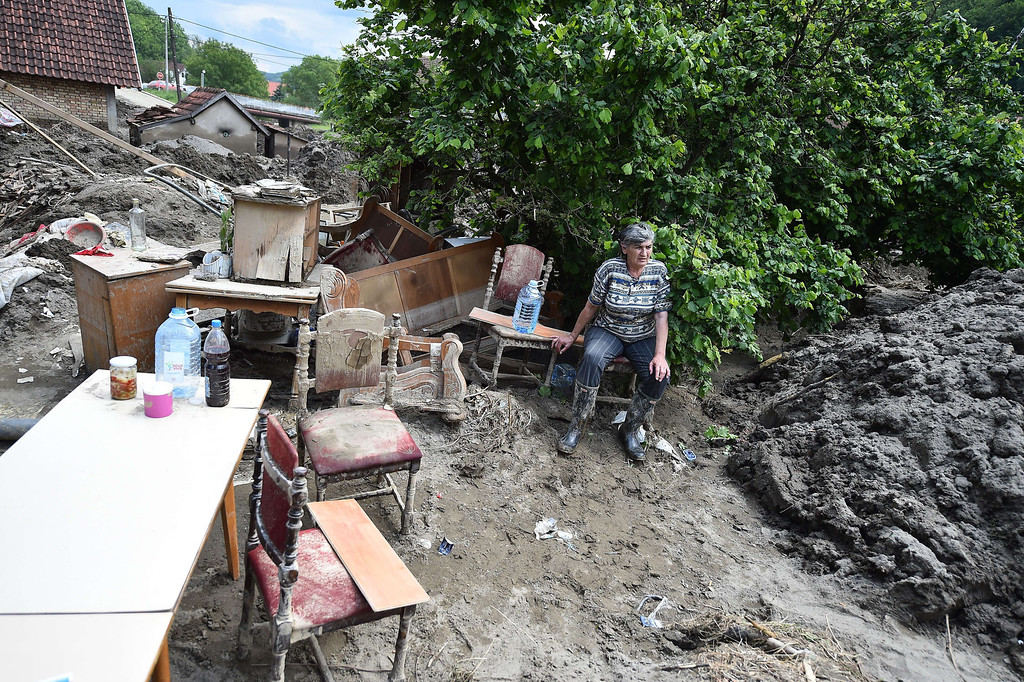 . A woman sits on a chair as she rests next to furniture in her mud covered back yard in Krupanj, some 130 kilometers south west of Belgrade, on May 20, 2014, after it was hit with floods and landslides, cutting the western Serbian town off for four days. Serbia declared three days of national mourning on May 20 as the death toll from the worst flood to hit the Balkans in living memory rose and health officials warned of a possible epidemic.   AFP PHOTO / ANDREJ ISAKOVIC/AFP/Getty Images