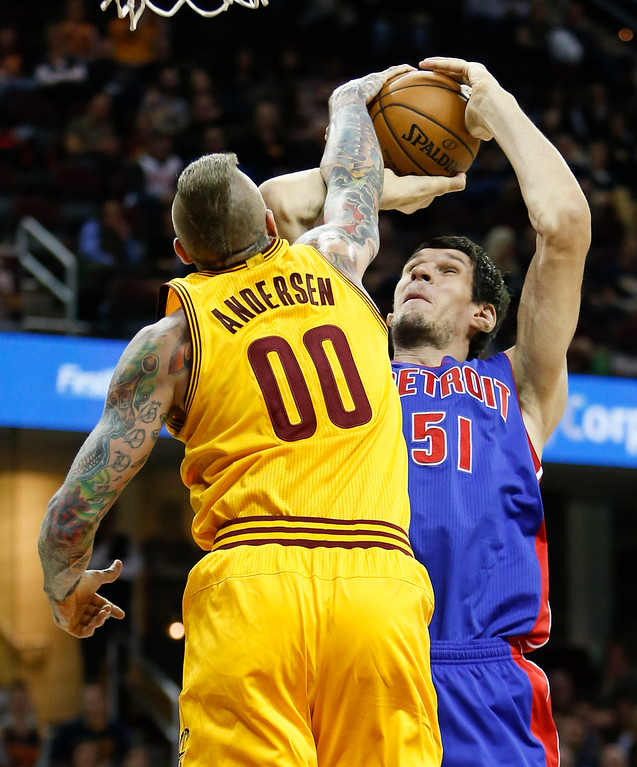 . Cleveland Cavaliers\' Chris Andersen (00) ties up Detroit Pistons\' Boban Marjanovic (51) for a jump ball during the second half of an NBA basketball game Friday, Nov. 18, 2016, in Cleveland. The Cavaliers won 104-81. (AP Photo/Ron Schwane)
