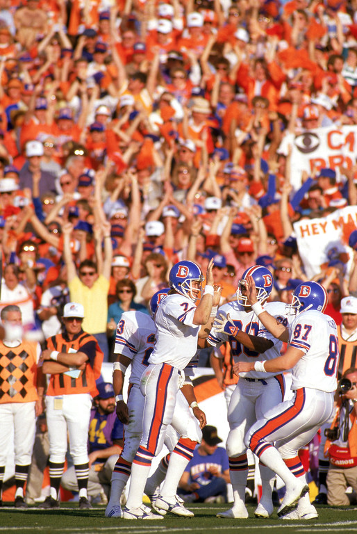 . Quarterback John Elway #7 of the Denver Broncos celebrates with teammates following a touchdown run during Super Bowl XXI against the New York Giants at the Rose Bowl on January 25, 1987 in Pasadena, California.   (Photo by George Rose/Getty Images)