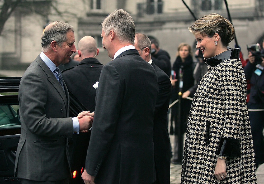 Description of . Belgian Prince Philippe (C) and Belgian Princess Mathilde (R), pregnant with her fourth child, welcome Prince Charles of Britain (L), 13 February at the Royal Castle of Laeken-Laken, in Brussels region. Prince Charles is on a two-day visit to Brussels. JOHN THYS/AFP/Getty Images