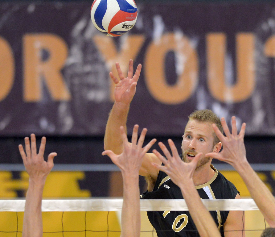 . Dalton Ammerman hits for LBSU in Long Beach, CA on Friday, March 7, 2014 #2 BYU vs #3 Long Beach State men\'s volleyball at Walter Pyramid. (Photo by Scott Varley, Daily Breeze)