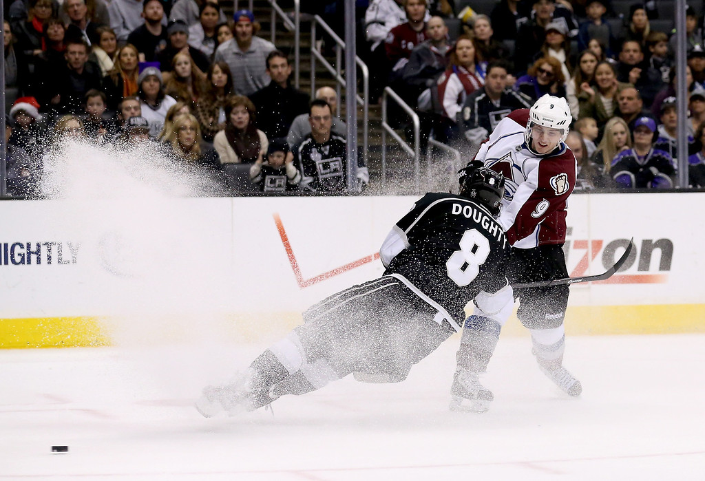 . LOS ANGELES, CA - DECEMBER 21:  Matt Duchene #9 of the Colorado Avalanche gets the puck past Drew Doughty #8 of the Los Angeles Kings at Staples Center on December 21, 2013 in Los Angeles, California.  The Kings won 3-2 on a shootout.  (Photo by Stephen Dunn/Getty Images)
