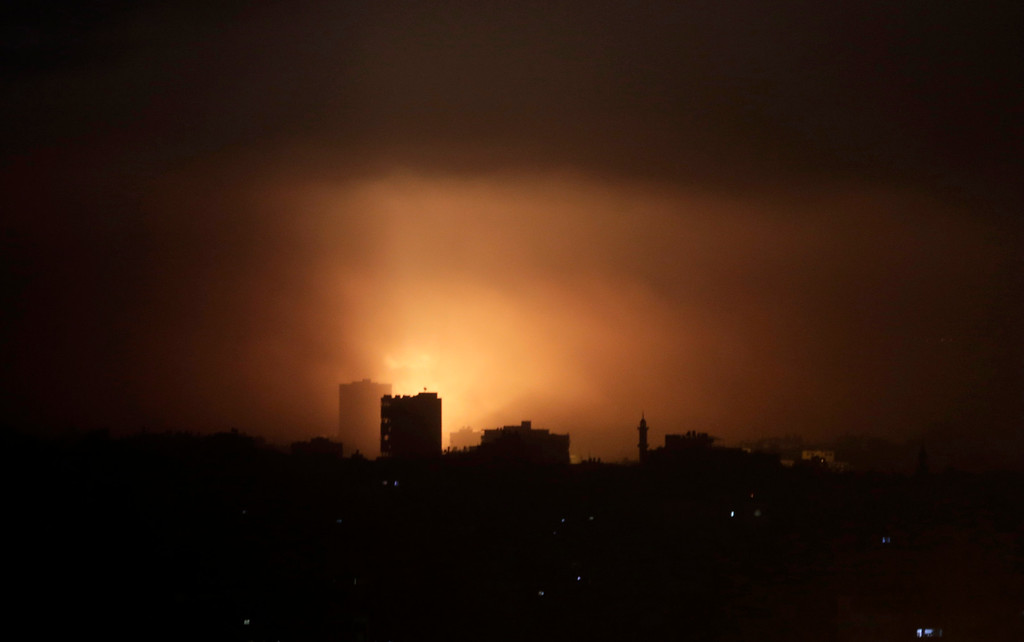 . An explosion from an Israeli strike lights up the sky in eastern Gaza City, early Wednesday, July 30, 2014, amid Israel\'s heaviest air and artillery assault in more than three weeks of Israel-Hamas fighting. (AP Photo/Khalil Hamra)