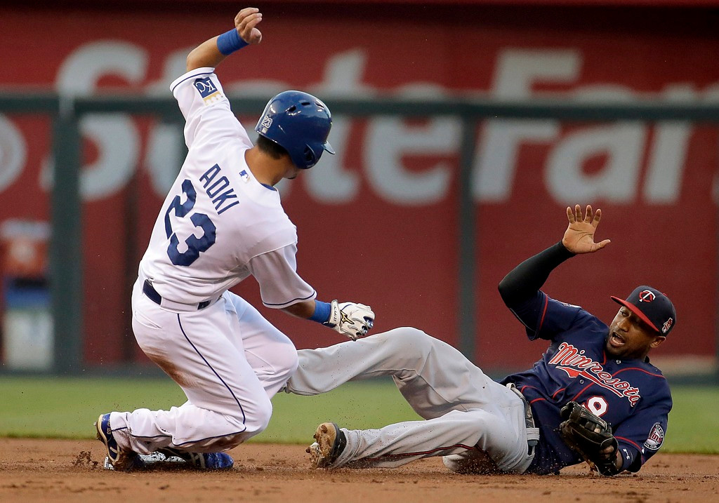 . Kansas City base runner Norichika Aoki, left, is forced out at second by Twins shortstop Eduardo Nunez on a ball hit by Alcides Escobar during the first inning. (AP Photo/Charlie Riedel)