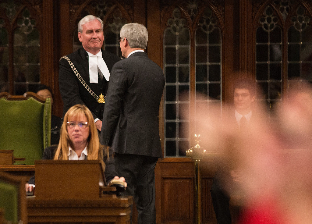 . In this handout photo provided by the PMO, Prime Minister Stephen Harper shakes hands with Kevin Vickers, Sergeant-at-Arms, following his remarks in the House of Commons addressing the attacks in the Nation\'s Capital, on October 23, 2014 in Ottawa, Canada. The gunman, identified as Michael Zehaf-Bibeau, was shot and killed by Kevin Vickers while still inside the Parliament building.  (Photo by Jason Ransom/PMO via Getty Images)