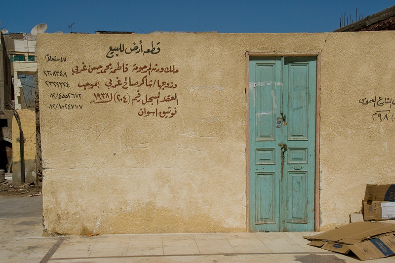 Doorway and wall with Arabic writings - Aswan, Egypt