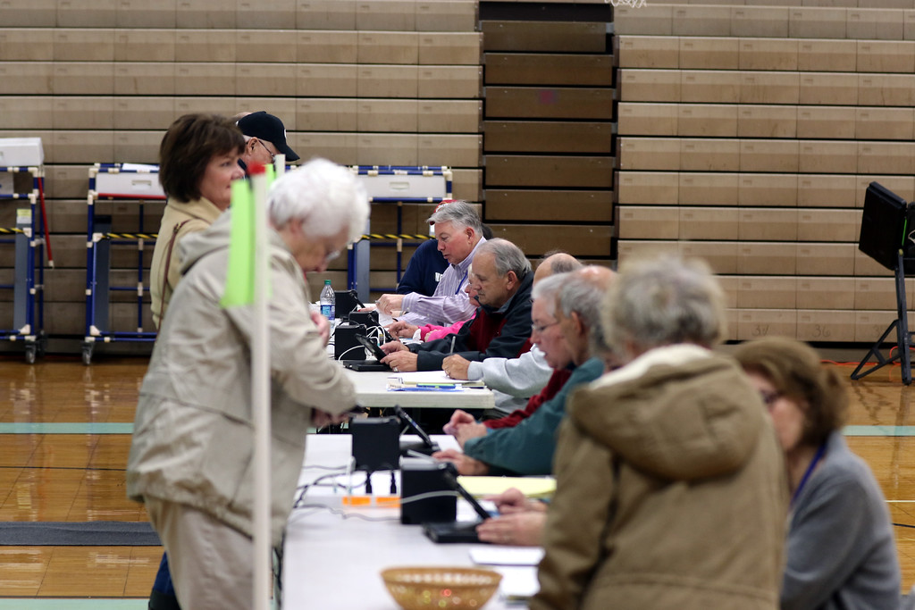 . Jonathan Tressler � The News-Herald <br> Lake County Elections Board poll workers check voters in Nov. 7 at Willoughby South High School.