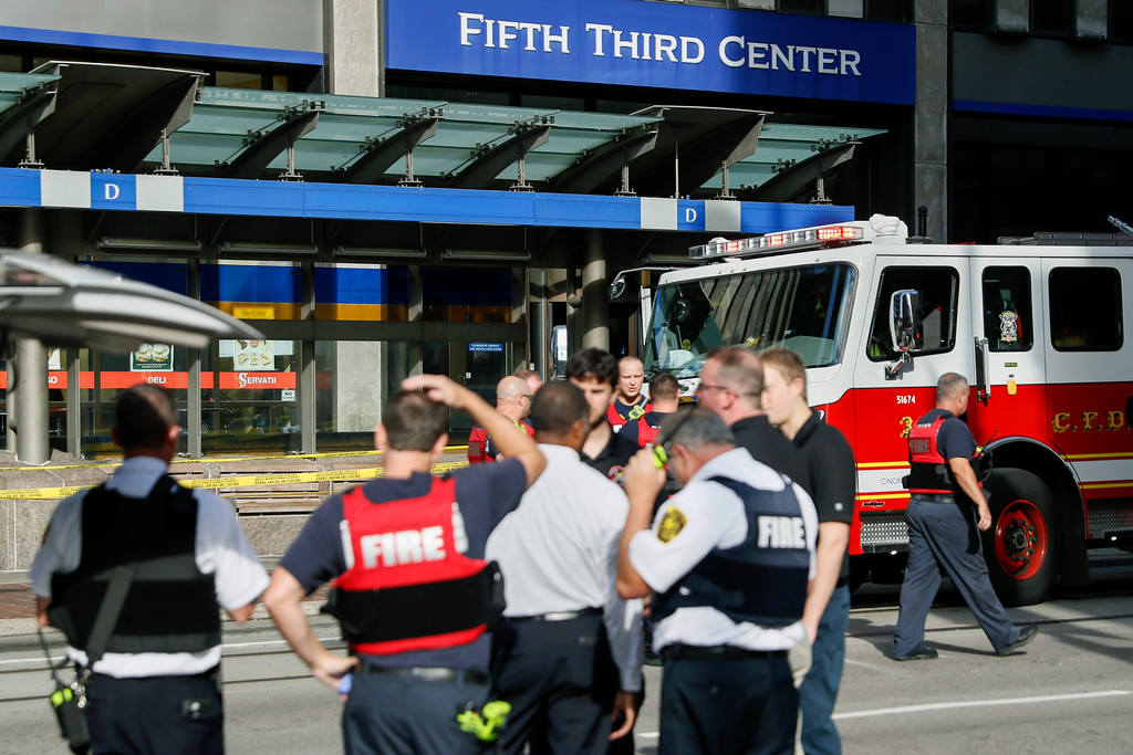 . Emergency personnel and police respond to reports of an active shooter situation near Fountain Square, Thursday, Sept. 6, 2018, in downtown Cincinnati. (AP Photo/John Minchillo)