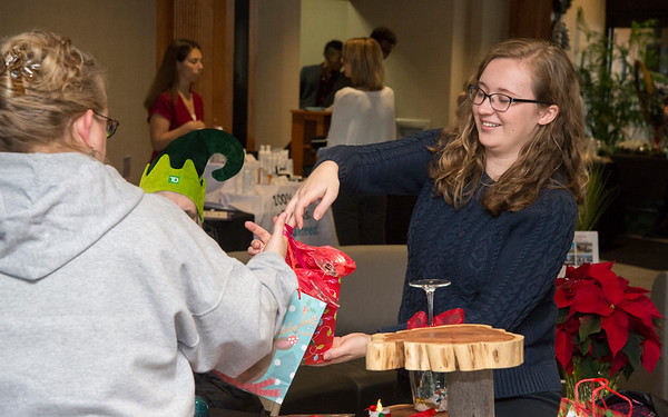 12/12/19 Wesley Bunnell | StaffrrMeaghan Gorman from Community Mental Health Associates helps a customer during the Holiday Craft Fair at 1 Liberty Square on Thursday afternoon.