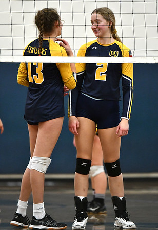 11/16/2019 Mike Orazzi | StaffrWoodstock Academy's Aurissa Boardman (13) and Amelia Large (2) during the 2019 State Girls Volleyball Tournament Class L Quarterfinals at BEHS in Bristol Saturday. r