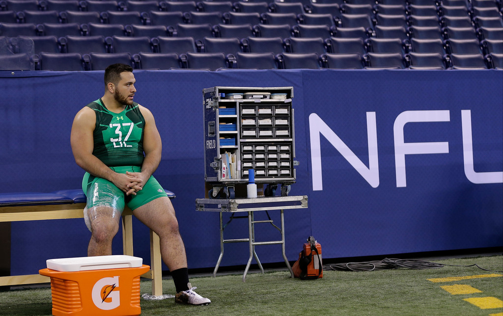 . Stanford defensive lineman David Parry sits on a trainer\'s table after running the 40-yard dash at the NFL football scouting combine in Indianapolis, Sunday, Feb. 22, 2015. (AP Photo/David J. Phillip)