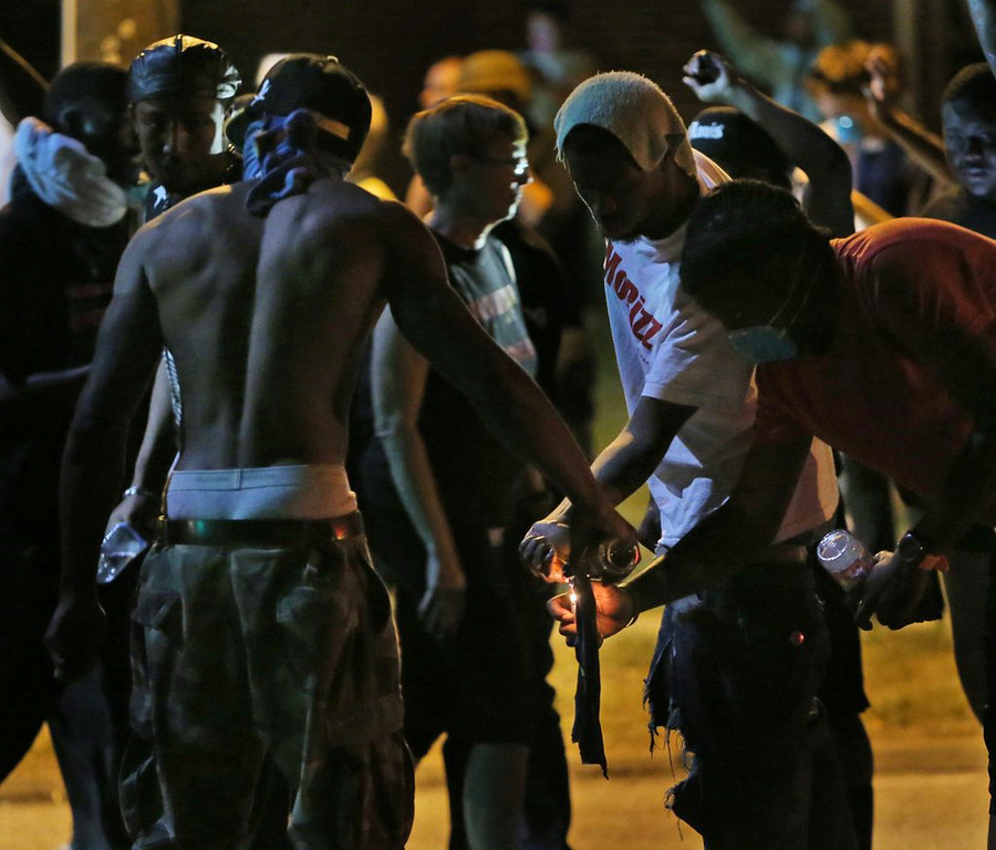 """. 1. (tie) FERGUSON PROTESTERS <p>Some are peaceful; some are fighting for their constitutional right to throw Molotov cocktails. (unranked) </p><p><b><a href=\""""http://www.hlntv.com/slideshow/2014/08/18/michael-brown-shooting-protesters-ferguson-missouri\"""" target=\""""_blank\""""> LINK </a></b> </p><p>   (AP Photo/St. Louis Post-Dispatch, Chris Lee)</p>"""