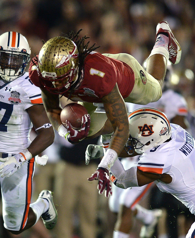 . Florida State\'s Kelvin Benjamin is upended by Auburn\'s Jermaine Whitehead in the second half of the BCS national championship game at the Rose Bowl, Monday, January 6, 2014. (Photo by Michael Owen Baker/L.A. Daily News)