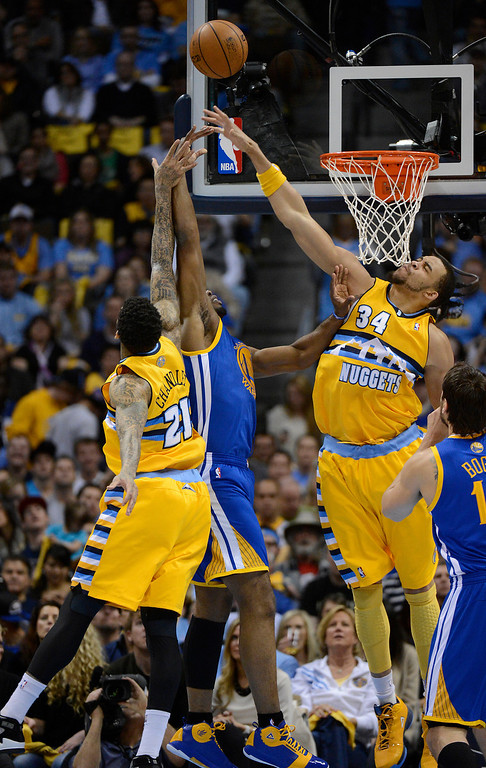 . DENVER, CO. - APRIL 20: Golden State Warriors power forward Carl Landry (7) puts up a shot while being defended by Denver Nuggets shooting guard Wilson Chandler (21) and Denver Nuggets center JaVale McGee (34) in the first quarter. The Denver Nuggets took on the Golden State Warriors in Game 1 of the Western Conference First Round Series at the Pepsi Center in Denver, Colo. on April 20, 2013. (Photo by John Leyba/The Denver Post)