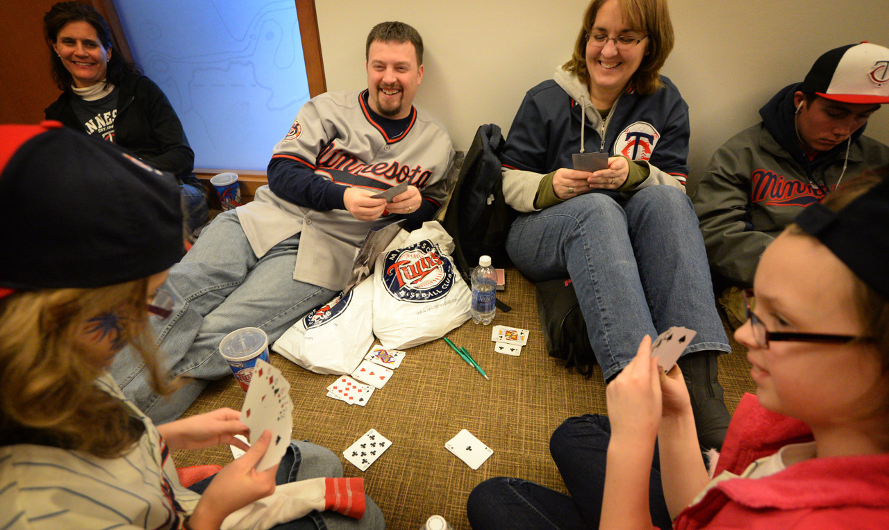 . The Brockman family from Marshall Minnesota play Go Fish while waiting in line to for an chance to get Twins prospect Bryon Buxton\'s autograph while at Twinsfest at Target Field, Saturday, January 25, 2014. Dad Cory and mom Sheila and younger sister Kendra, right, nine years-old, wait for eleven year-old Sydney to make a play. (Pioneer Press: John Autey)