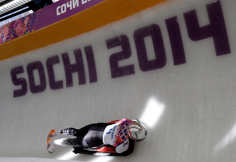 . Janine Flock of Austria speeds down the track in her first run during the women\'s skeleton competition at the 2014 Winter Olympics, Thursday, Feb. 13, 2014, in Krasnaya Polyana, Russia. (AP Photo/Michael Sohn)