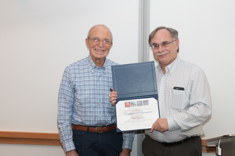 Peter accepts his retirement certificate from Rob Petre -- Retirement party for Peter Serlemitsos from NASA/GSFC after 55 years. -- April 27, 2017 -- NASA/Goddard Space Flight Center, Greenbelt, MD